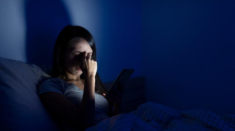 Woman experiencing sleep disruption